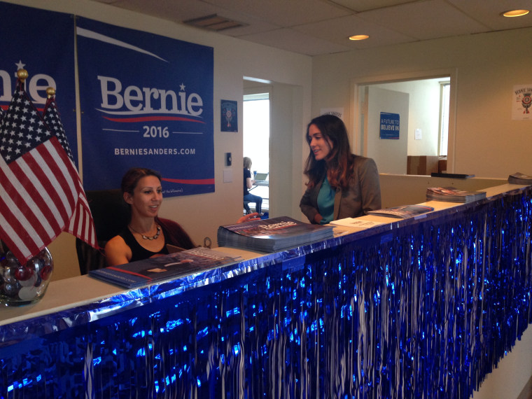 Giulianna Di Lauro speaks with receptionist Laura Hoffmen at the Bernie Sanders campaign office in Orlando, Florida.