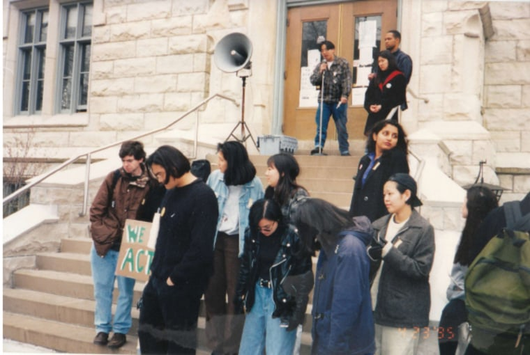 A rally during the 1995 hunger strike in front of University Hall at Northwestern University. Jen Abellera, Eric Salcedo, and Rob Yap are at the microphone.