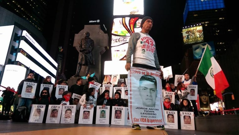 Activists from Mexico and the United States gather in the Times Square to support Antonio Tizapa, a father running the NYC Half Marathon to demand the return of his son and 42 other missing students.