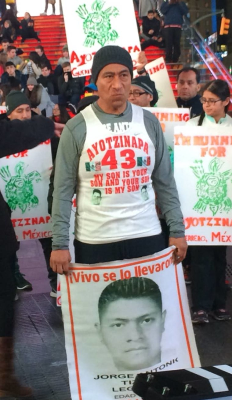 Antonio Tizapa leads protesters in Times Square to demand the return of his son and 42 other students.