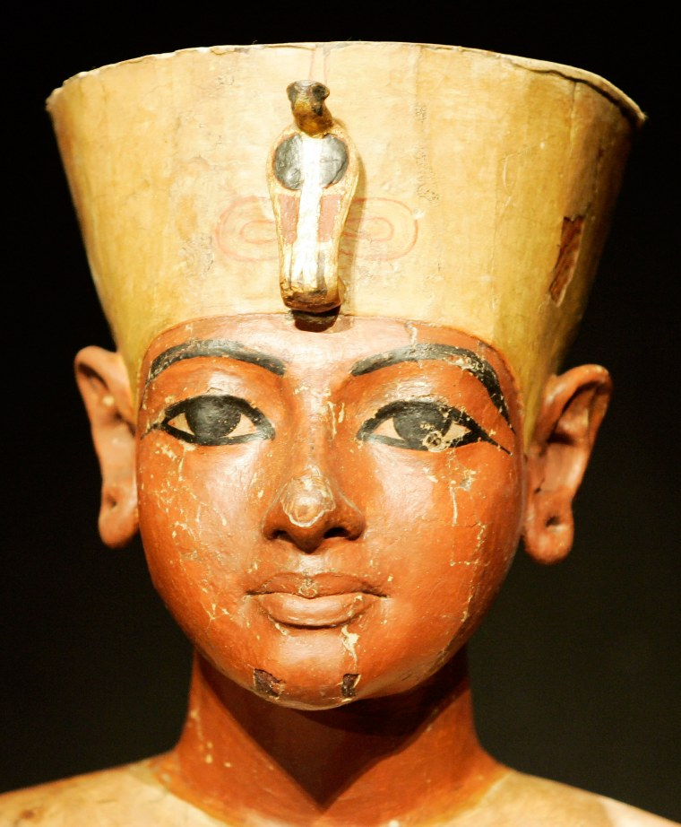 iMAGE: The mannequin head, carved of wood, of Tutankhamun is displayed