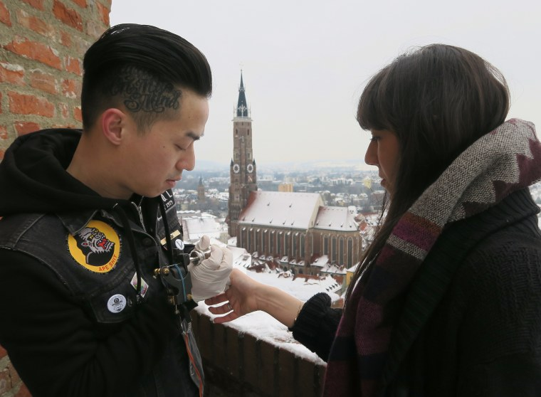 Adam Vu tattooing in the open air at a German castle.