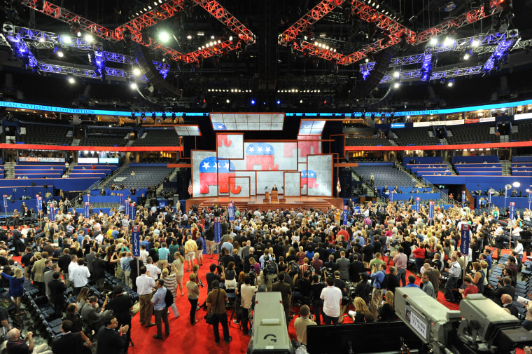 Image: Delegates listen to the Chairman of the Republican National Convention (RNC) Reince Priebus