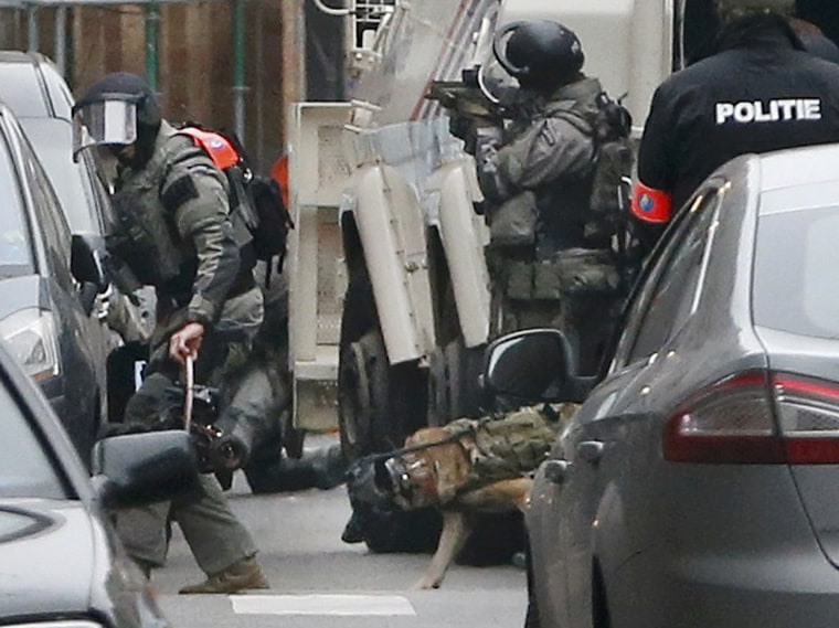 Image: Police at the scene of a security operation in the Brussels suburb of Molenbeek in Brussels, Belgium.