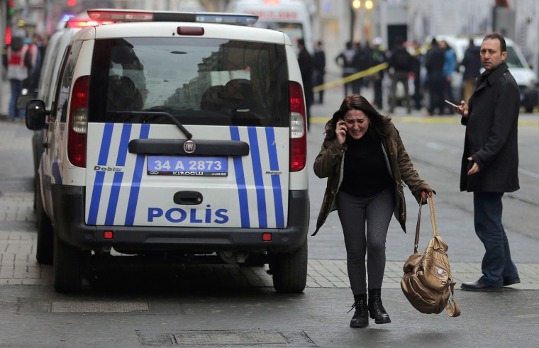 Image: Woman reacts following a suicide bombing in central Istanbul