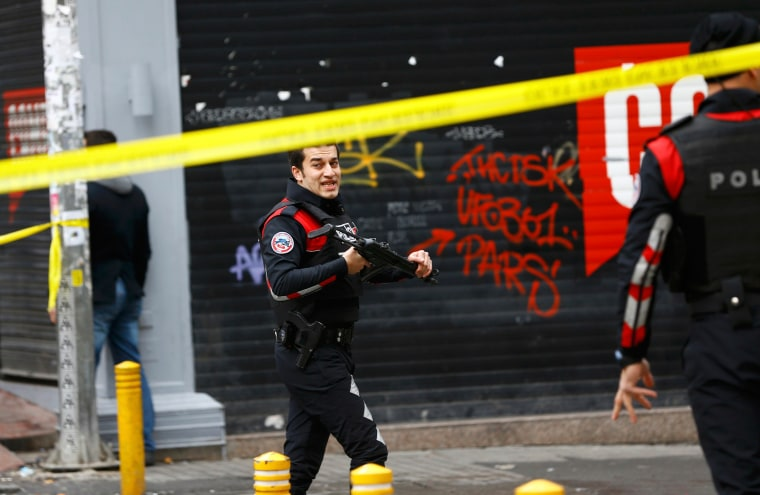Image: Police secure the area following a suicide bombing in a major shopping and tourist district in central Istanbul