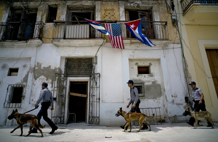 Image: Cuban police arrive to the area where President Barack Obama will visit upon arrival in Old Havana