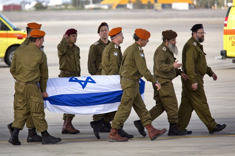 Image: Israeli army officers unload a coffin of an Israeli, that was killed in a suicide attack in Turkey