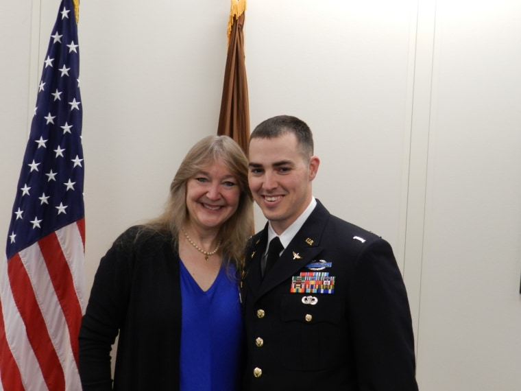 Buddy and his mom on the day he was commissioned Warrant Officer in 2014.