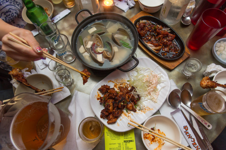 "A Koreatown bar food scene in Chicago from ""Koreatown,"" a cookbook detailing traditional recipes."