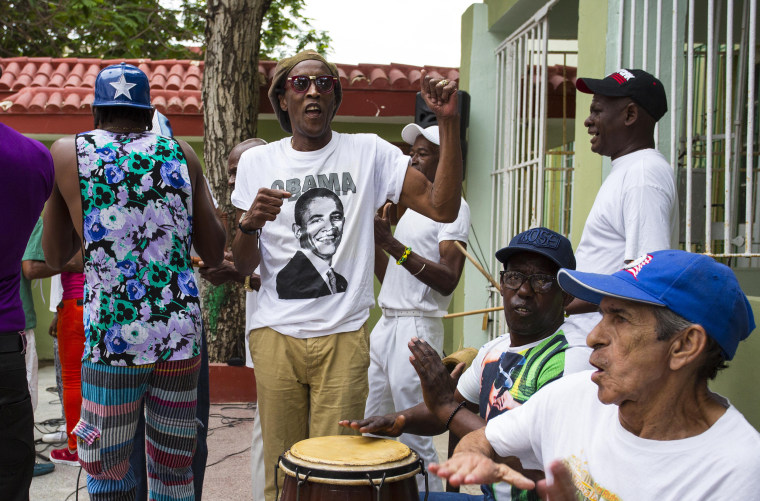 Image: A musician performs wearing a T-shirt designed with an image of President Barack Obama