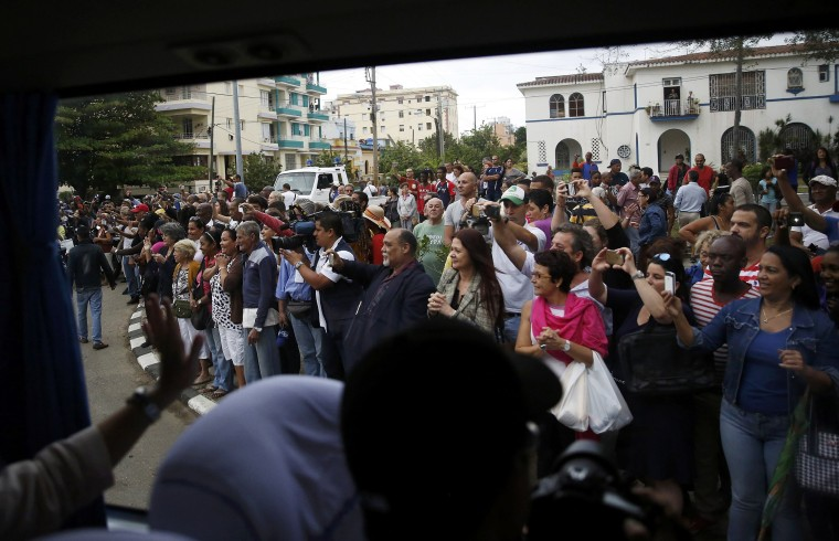 Image: Cubans line the road to see the motorcade of U.S. President Barack Obama in Havana