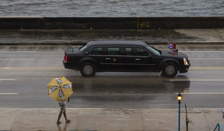 Image: The vehicle carrying President Barack Obama drives along the Malecon sea wall