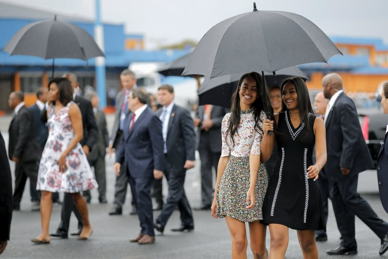 Image: Malia and Sasha Obama arrive with their parents at the Jose Marti international airport