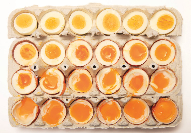 "A photo of eggs cooked to different temperatures included in ""The Food Lab"" by J. Kenji López-Alt."
