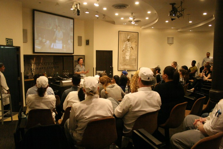 J. Kenji López-Alt hosting a cooking demonstration at the International Culinary Center.