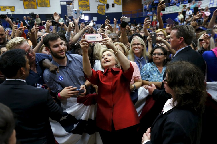 Image: Democratic U.S. presidential candidate Clinton takes a selfie with supporters at a campaign rally at Carl Hayden Community High School in Phoenix