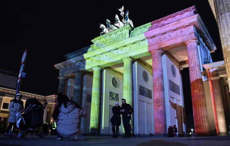 Image: The colors of the Belgian flag are projected on to the Brandenburg Gate