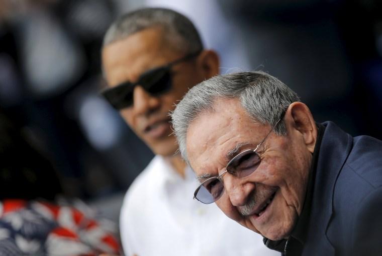 Image: U.S. President Barack Obama and Cuban President Raul Castro arrive to attend a baseball game at Estadio Latinoamericano in Havana