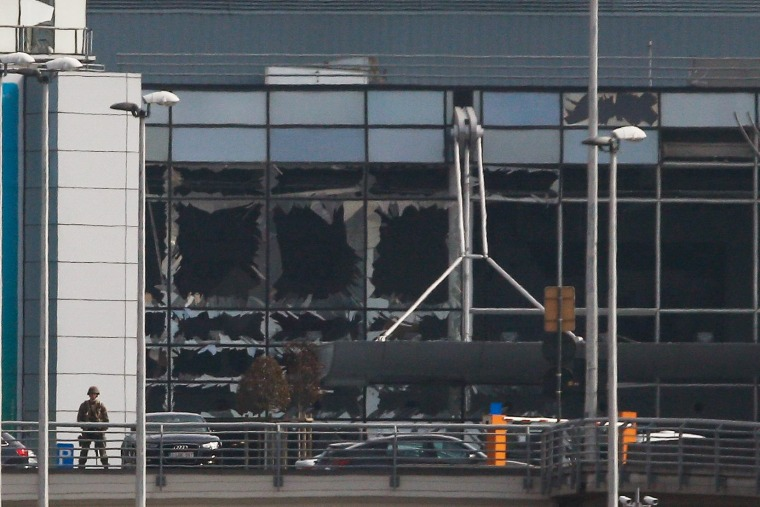 Image: Destroyed windows at the terminal building after explosions at Brussels Airport