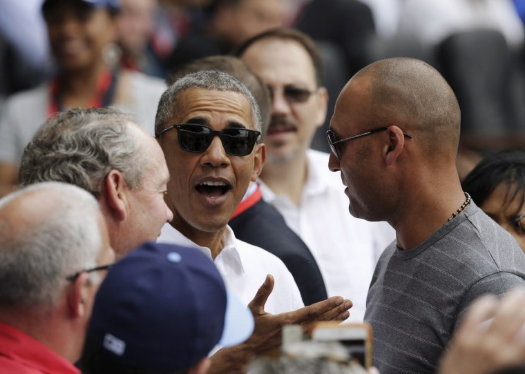 Image: U.S. President Obama talks with former New York Yankees shortstop Jeter during an exhibition baseball game between the Cuban national team and the MLB Tampa Bay Rays at Estadio Latinoamericano in Havana