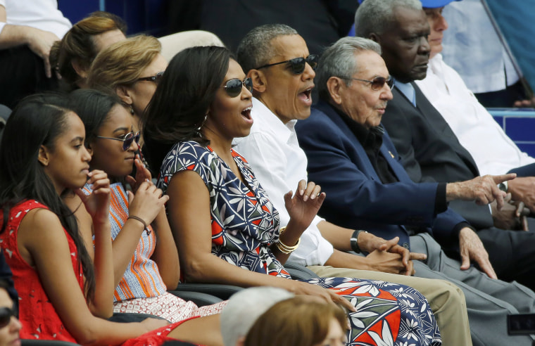 Image: U.S. President Barack Obama and his family react along with Cuban President Raul Castro to an exhibition baseball game in Havana