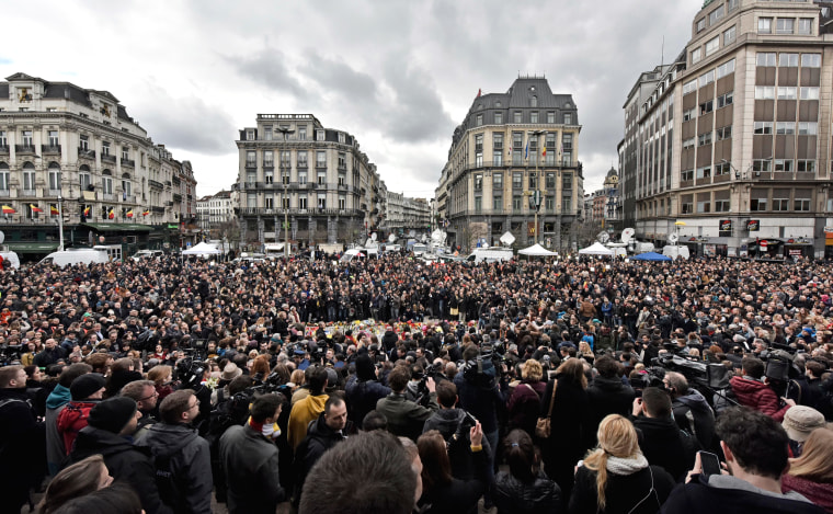 Image: People observe a minute of silence at the Place de la Bourse