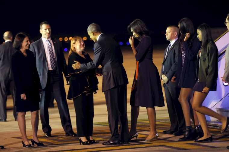 Image: U.S. President Barack Obama greets Argentina's Foreign Minister Susana Malcorra, as he arrives with his family at Buenos Aires' international airport