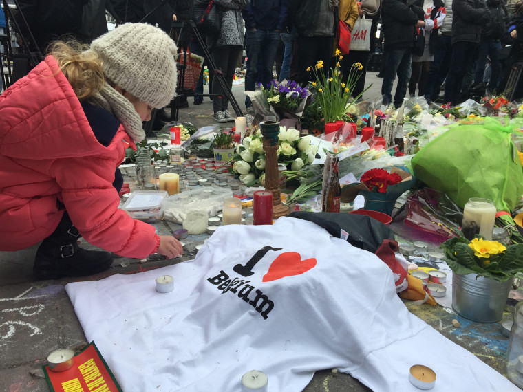 Image: A girl at the vigil site at Place de la Bourse in Brussels