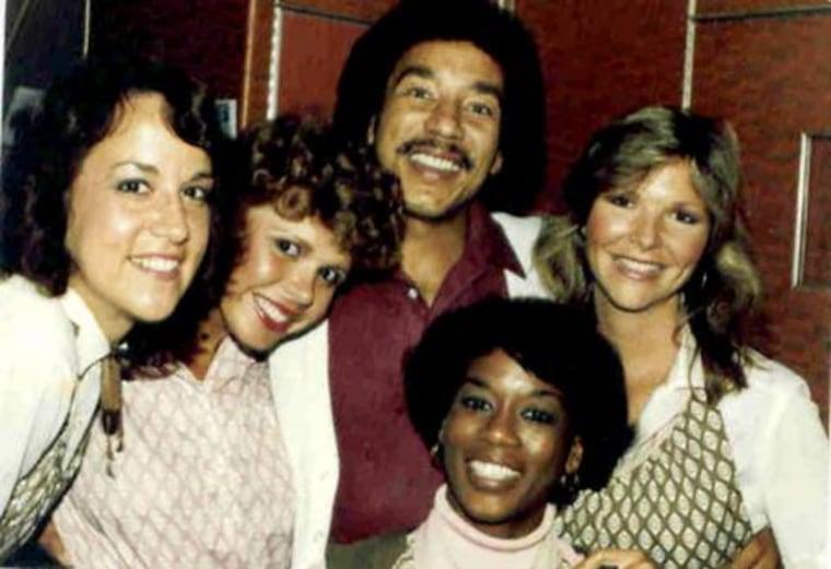 Casey Grant, shown here with Motown legend Smokey Robinson and fellow flight attendants Debbie Phillips, Sharon Hirtzer, Ellen Lucas, says meeting celebrities was a great perk of the job.