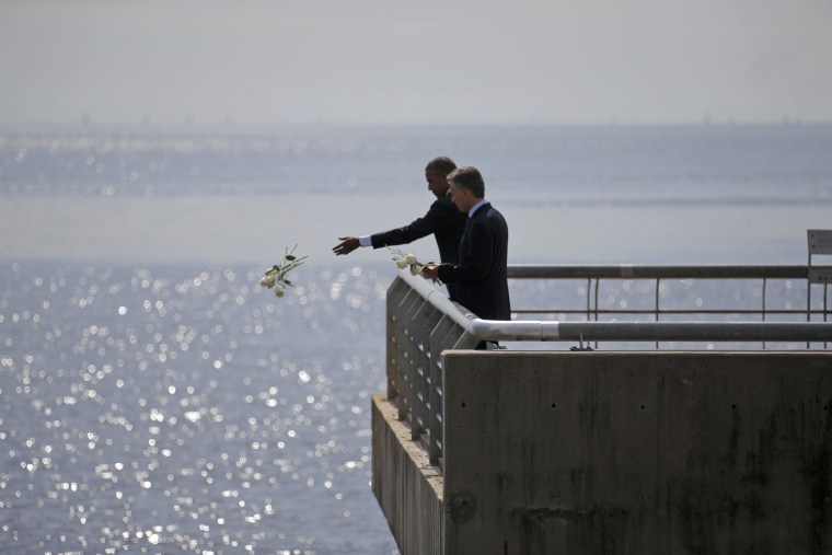 Image: U.S. President Barack Obama and Argentina's President Mauricio Macri visit the Parque de la Memoria in Buenos Aires