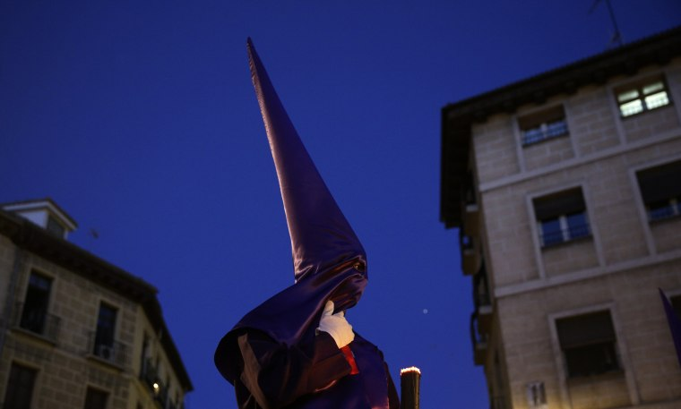 "Image: A penitent takes part in the ""Jesus el Pobre"" brotherhood procession during Holy Week in Madrid"