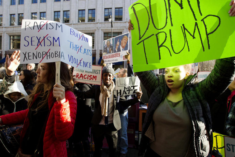 Demonstrators protest outside of the Verizon Center in Washington, Monday, March 21, 2016, where the 2016 American Israel Public Affairs Committee (AIPAC) Policy Conference is taking place in Washington, Monday, March 21, 2016. Republican presidential candidates Donald Trump, John Kasich and Ted Cruz are speaking at the conference on Monday. (AP Photo/Jose Luis Magana)