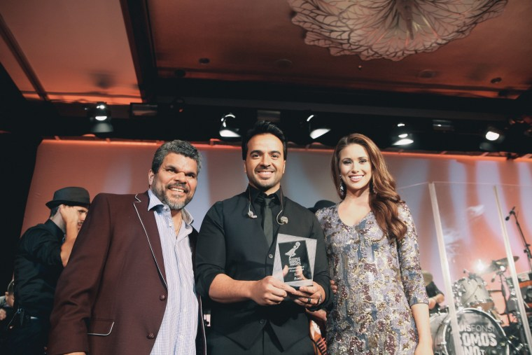 Actor Luis Guzmán, singer Luis Fonsi, and Miss USA Nia Sanchez.  Sanchez and Guzmán served as masters of ceremony for the Positive Impact Awards during the Hispanicize Event 2015.