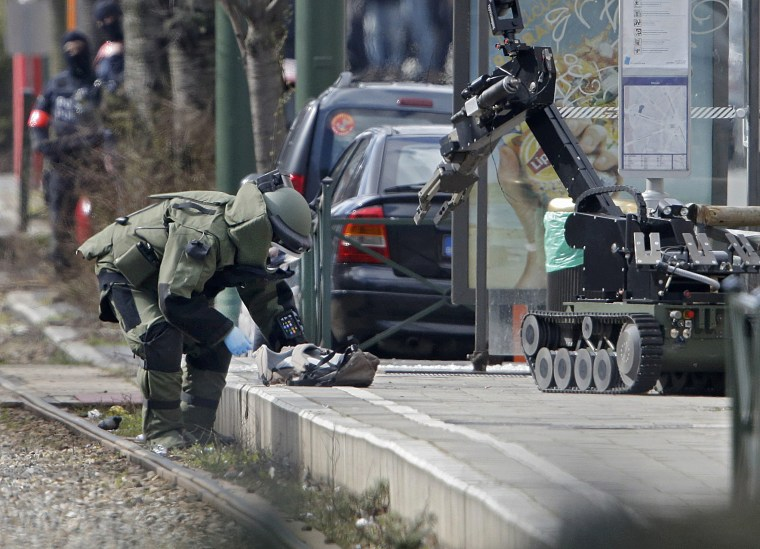Image: Police operation in Schaebeek area of Brussels