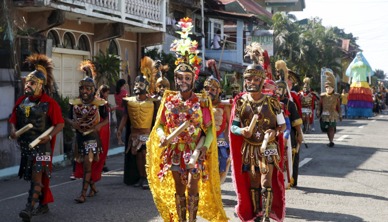 "Image: Penitents locally called ""Morions"" wear masks and centurion garbs as they take part in a Good Friday procession as part of Holy Week celebration in Gasan, Marinduque"