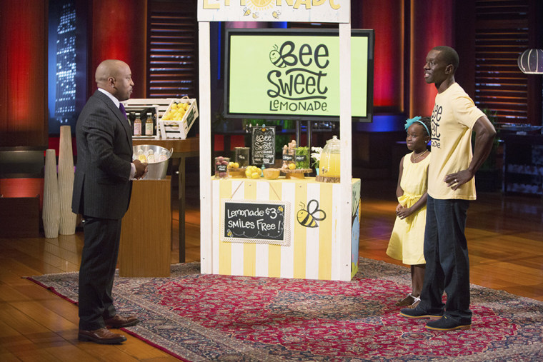 """Mikaila Ulmer with her father on the TV show, """"Shark Tank,"""" where she secured $60,000 for her business."""