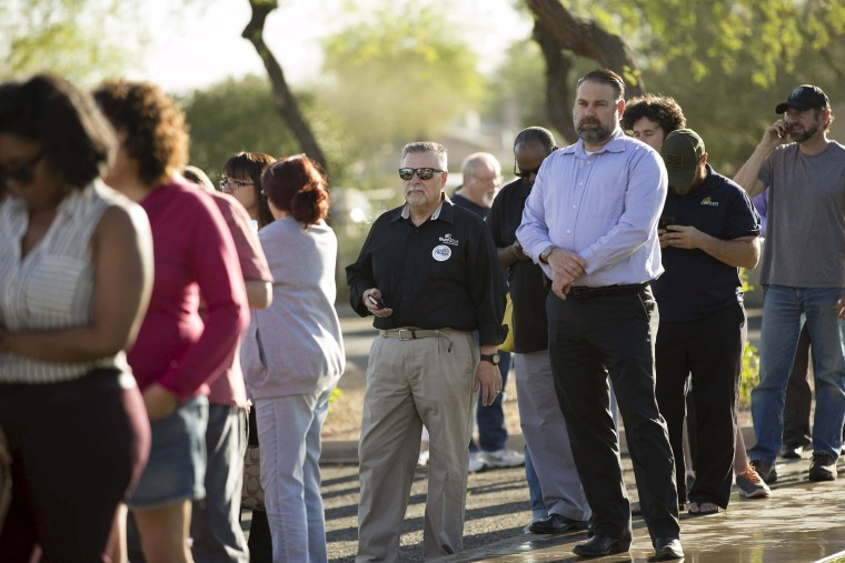 Image: People wait to vote in U.S. presidential primary election at polling site in Arizona