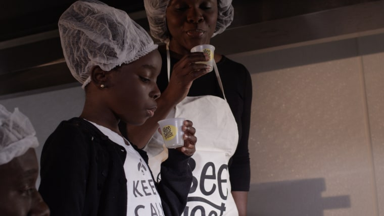 Founder of BeeSweet Lemonade Mikaila Ulmer tests out a sample of her product.