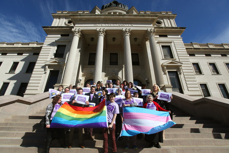 Representatives from the Center for Equality, American Civil Liberties Union of South Dakota, LGBT supporters and members of the Human Rights Campaign stand on the front steps of the State Capitol to honor Trans Kids Support Visibility Day in Pierre, S.D. on Tuesday, Feb. 23, 2016.
