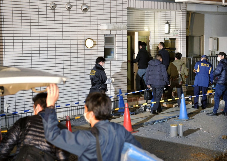 Image: Police at apartment of abduction suspect in Tokyo