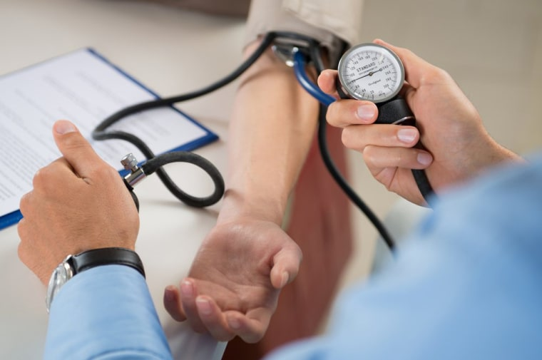 Image: Doctor Checking Blood Pressure Of A Patient