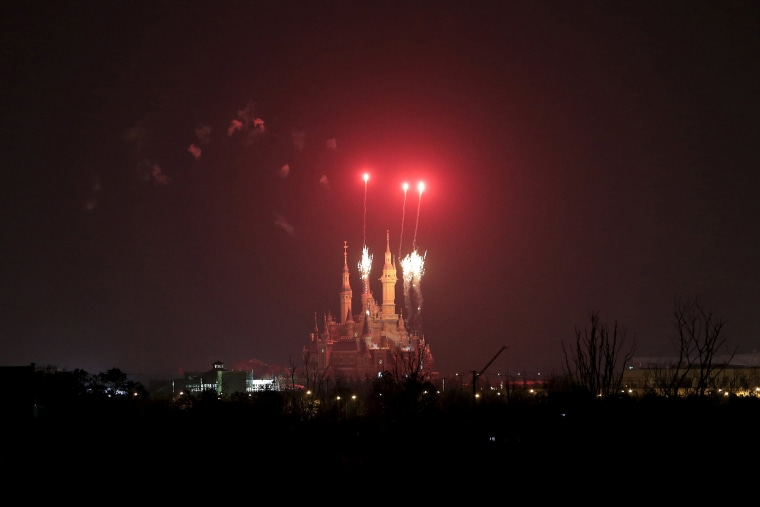 Image: Fireworks explode over Shanghai Disney Resort in Shanghai