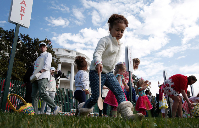 Image: Young children roll Easter eggs on the South Lawn of the White House