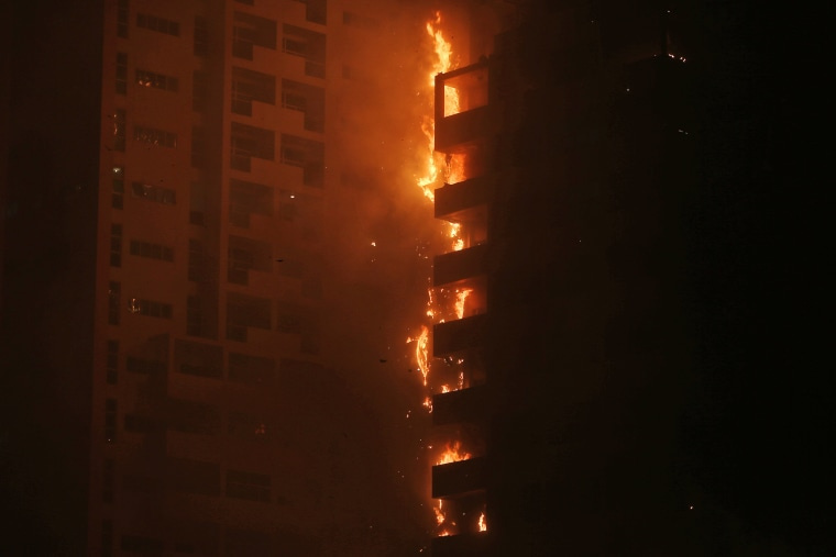 Image: Fire and smoke billow from a high-rise building in Ajman