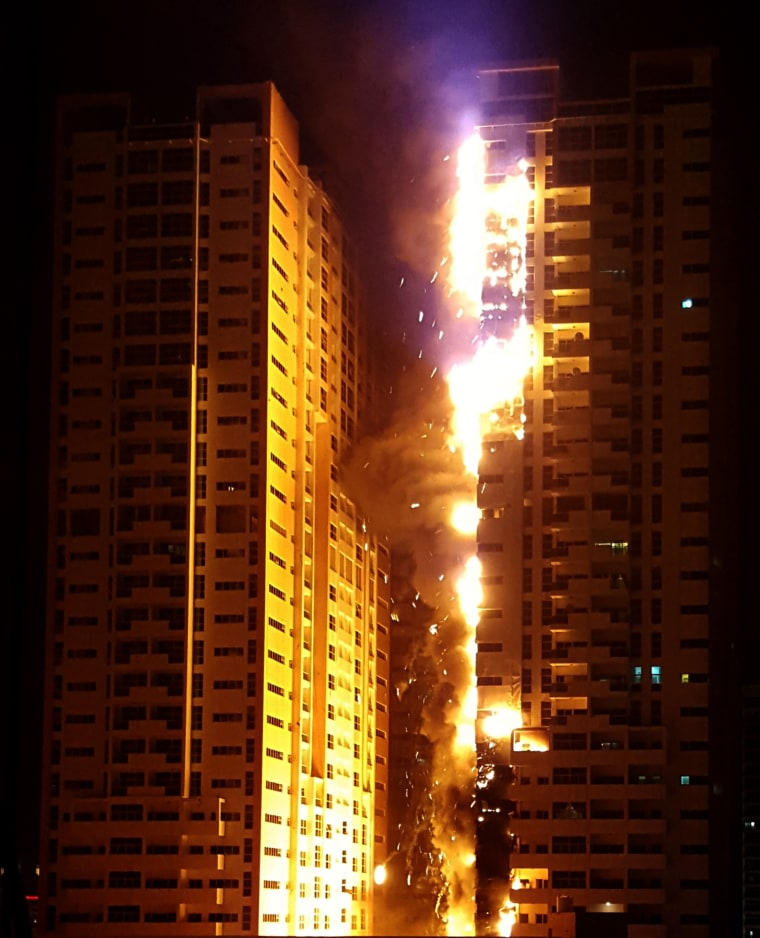 Image: Fire engulfs a tower at a residential cluster in Ajman