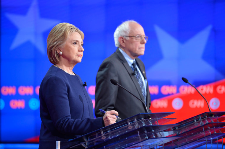 Image: U.S. Democratic Presidential candidates Hillary Clinton (L) and Bernie Sanders