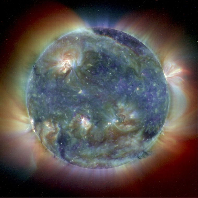 An ultraviolet image released on March 21 shows the sun's intricate atmosphere. The sun is a prodigious nuclear reactor that sits at the heart of our planetary system and supplies our world with all the light and heat needed for us to exist. To the human eye, the sun is a burning light in the sky to bright to look at, but through the electronic eyes of the Solar and Heliospheric Observatory (SOHO), we can appreciate delicate beauty and detail of it's atmospher. SOHO's extreme-ultraviolet telescope was used to take these images. This telescope is sensitive to four wavelengths of extreme-ultraviolet light, and the three shortest were used to build this image. Each wavelength has been color-coded to highlight the different temperatures of gas in the Sun.