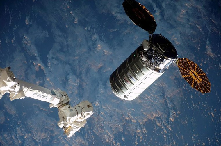 Image: The Cygnus cargo ship nears the robotic arm at the International Space Station