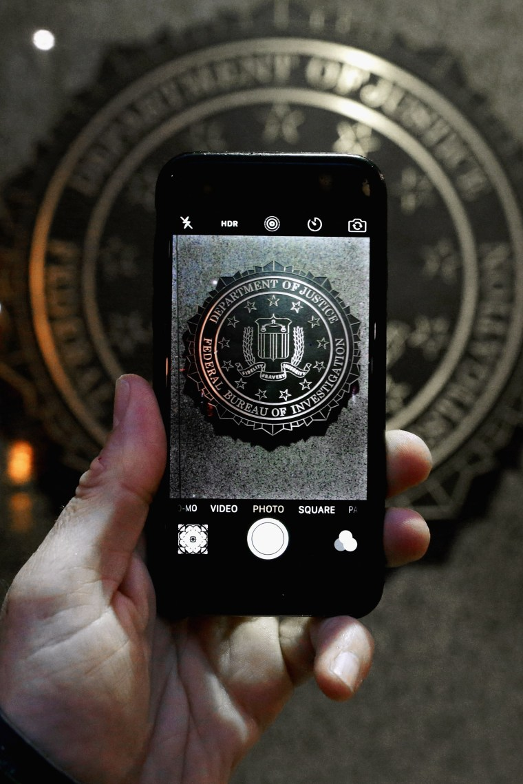 Image: AThe official seal of the FBI is seen on an iPhone's camera screen in this file photo.